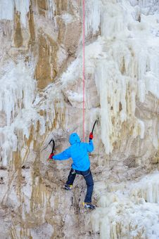 Young Man Climbing The Ice Royalty Free Stock Image