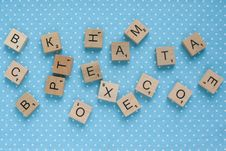 Free Wooden Square Scrabble Chips On A Blue Background Royalty Free Stock Images - 35792169