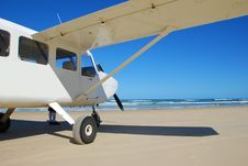 Light Aircraft On Beach Stock Image