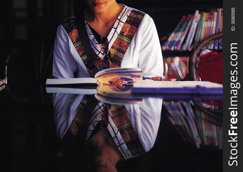 Oriental girl reading book