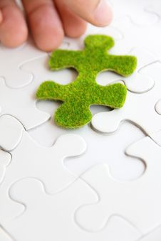 Free Hand Holding A Green Puzzle Piece Stock Photo - 35800820