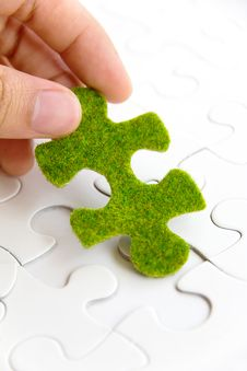 Free Hand Holding A Green Puzzle Piece Stock Photos - 35800833