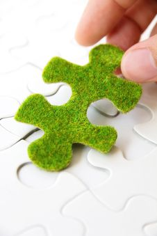 Free Hand Holding A Green Puzzle Piece Royalty Free Stock Photo - 35800835