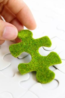 Free Hand Holding A Green Puzzle Piece Stock Photos - 35800843