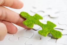 Free Hand Holding A Green Puzzle Piece Stock Photo - 35800870