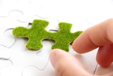 Free Hand Holding A Green Puzzle Piece Stock Images - 35800894