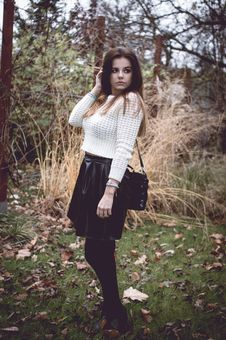 Beautiful Brunette Woman In White Sweater Royalty Free Stock Photography