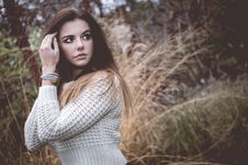 Beautiful Brunette Woman In White Sweater Stock Photos