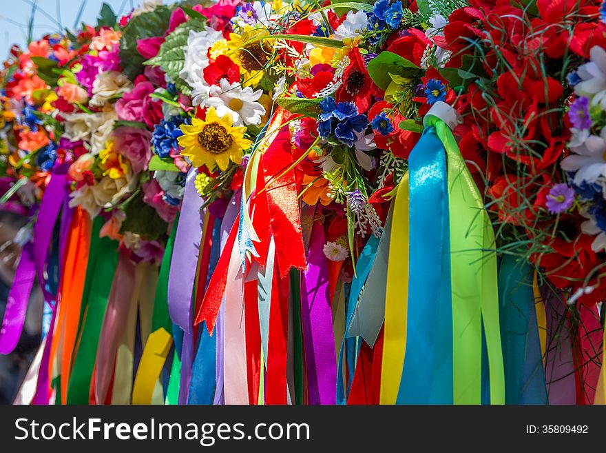 Wreath of flowers and ribbons, national cloths of Ukraine