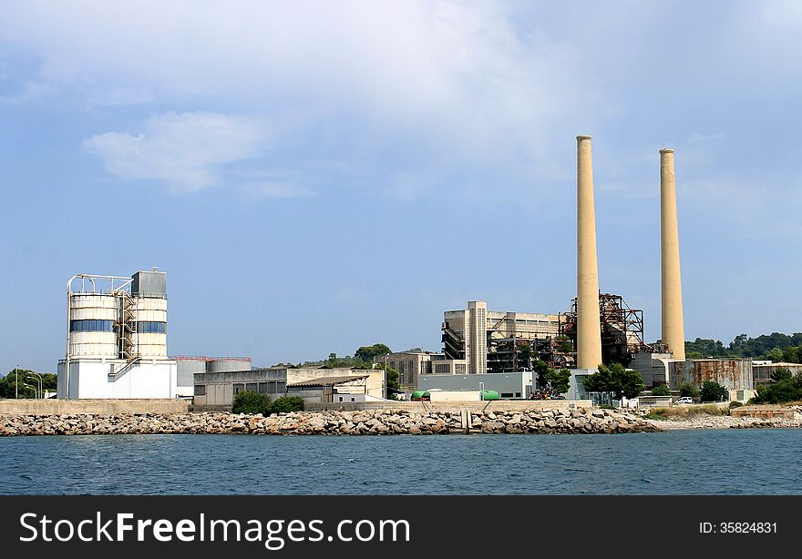 Industrial factory with tall chimney