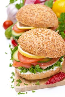 Free Burger With Smoked Salmon And Vegetables, Isolated Stock Image - 35856031