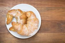 Free Croissants On A Plate On A Wooden Background Stock Photo - 35856200