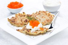Potato Pancakes With Red Caviar And Sour Cream On The Plate Royalty Free Stock Images
