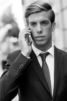 Free Attractive Young Businessman On The Phone In Urban Background Royalty Free Stock Images - 35858769