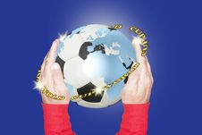 Free Soccer Ball With Continents Painted On It And Held With Two Hands Stock Images - 35863074