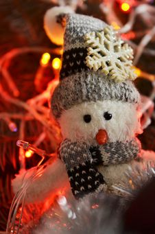 New Year`s Composition Of A Snowman And Lights Royalty Free Stock Photos