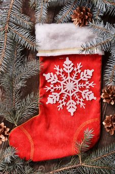 Composition Of A Red Christmas Sock And Fir Branches Stock Images