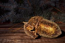 Golden Acorn And Spruce Twigs On A Wooden Background Royalty Free Stock Images