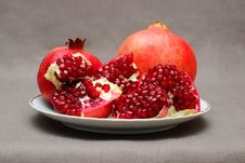 Ripe Pomegranate On A Plate Stock Image