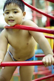 Free Kid Playing In Playground Royalty Free Stock Image - 3599866