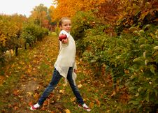 Pretty Girl With An Apple In His Hand Stock Image