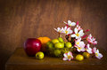Free Plumeria Flower And Many Fruit On Old Wood Table Royalty Free Stock Images - 35914389