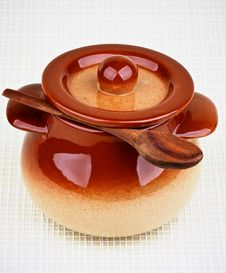 Stoneware Pot And Spoon Stock Photo