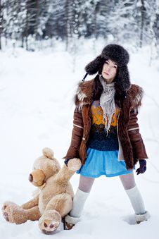 Free Woman In Fur Coat And Ushanka With Bear On White Snow Winter Background Stock Photo - 35920550