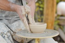 Free Craftsman Making Vase From Fresh Wet Clay On Pottery Wheel Stock Photos - 35921183
