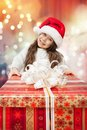 Free Child In Santa Hat With Gift Box. Stock Image - 35932421