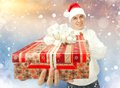 Free Young Man In Santa Claus Hat Holding A Gift Box Royalty Free Stock Photos - 35932448