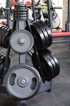 Free Barbell Plates Rack Royalty Free Stock Images - 35930389