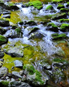 Free Mossy Rocks With Flowing Water From Mountains Royalty Free Stock Image - 35937816