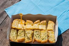 Free Fresh-baked Garlic Bread With Herbs, On White Bread Tray Stock Image - 35940171