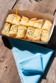 Fresh-baked Garlic Bread With Herbs, On White Bread Tray Royalty Free Stock Image