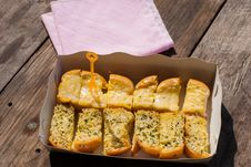 Fresh-baked Garlic Bread With Herbs, On White Bread Tray Stock Images