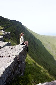 Free GIRL SITTING ON THE TOP OF A CLIFF Royalty Free Stock Images - 35941049