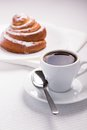 Free Cup Of Black Coffee With A Sweet Bun Stock Photos - 35953763