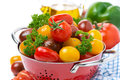 Free Assorted Cherry Tomatoes And Greens In A Colander, Close-up Royalty Free Stock Photography - 35959737