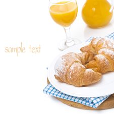 Croissants On A Plate And Orange Juice, Isolated Stock Image
