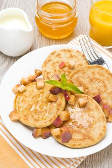 Pancakes With Peaches And Honey For Breakfast, Top View Royalty Free Stock Photo