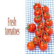 Cherry Tomatoes On A Blue Napkin, Isolated Stock Photo