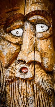 Face Carved Into Wood Stock Photo