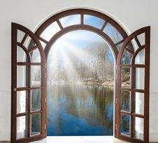 Open Door And A Winter Forest Stock Photo
