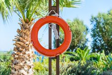 Life Buoy With Rope Hanging Around The Pool Royalty Free Stock Image