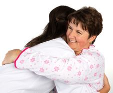 Free A Senior Woman And Nurse Hugging Stock Photo - 35973190