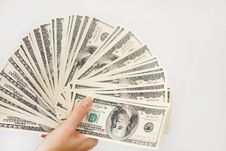 Free A Young Woman With Dollars In Her Hands, Isolated On White Stock Photos - 35986893