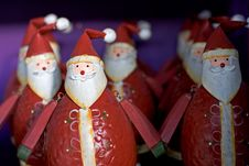 Free Rows Of Funny Santas For Sale On A Shelf Stock Image - 365451
