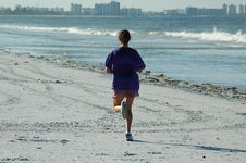 Free Female Jogger On The Beach Stock Photography - 368632