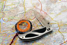 Compass And Knife On A Map Stock Photos